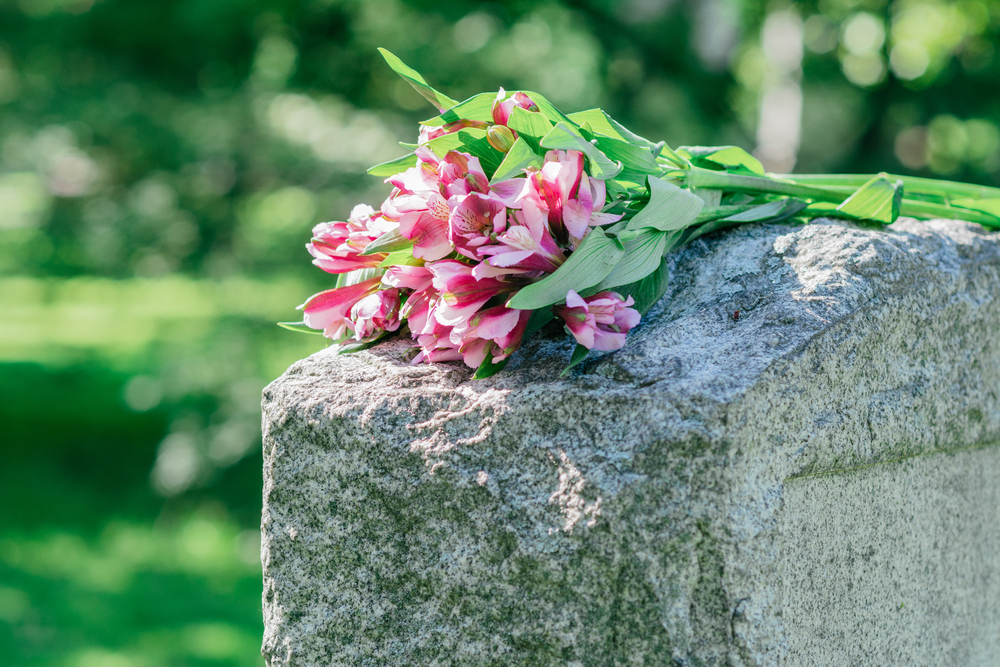Flowers on headstone in cemetery