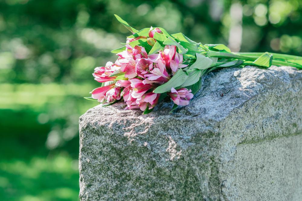 Flowers on headstone in cemetery